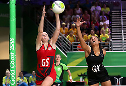 England's Joanne Harten (GS) stretches for the ball as New Zealand's Temalisi Fakahokotau (GK) attempts to block in the netball at the Gold Coast Convention and Exhibition Centre during day seven of the 2018 Commonwealth Games in the Gold Coast, Australia.