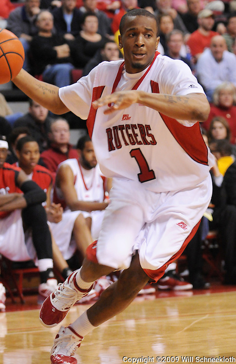 Feb 22, 2009; Piscataway, NJ, USA; Rutgers guard Corey Chandler (1) drives to the basket during the second half of Rutgers' 74-56 loss to West Virginia at the Louis Brown Athletic Center.