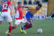 Jamie Ward of Charlton Athletic (16) and Jacob Mellis of Mansfield Town (8) battle for the ball during the The FA Cup match between Mansfield Town and Charlton Athletic at the One Call Stadium, Mansfield, England on 11 November 2018.