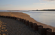 The Knolls shingle banks of the River Deben estuary at its mouth, Bawdsey Quay, Suffolk, England