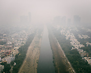 Visible air pollution above a polluted open air sewage in Noida, near Delhi, India.