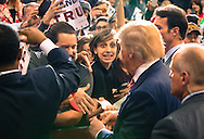 Donald Trump singing autographs in Baton Rouge at a rally.