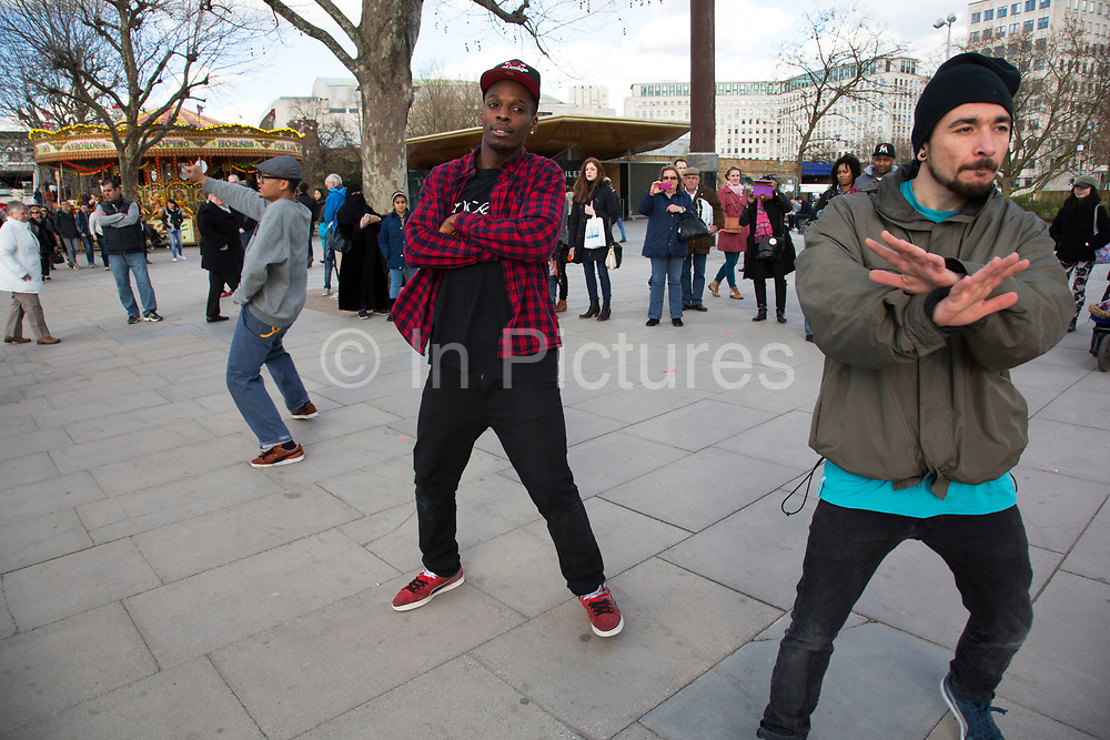 King Corville street performers perform a Gangnam Style street dance to a delighted audience on the Southbank. The South Bank is a significant arts and entertainment district, and home to an endless list of activities for Londoners, visitors and tourists alike.