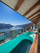 Terrace with empty pool and lake view in a luxury house