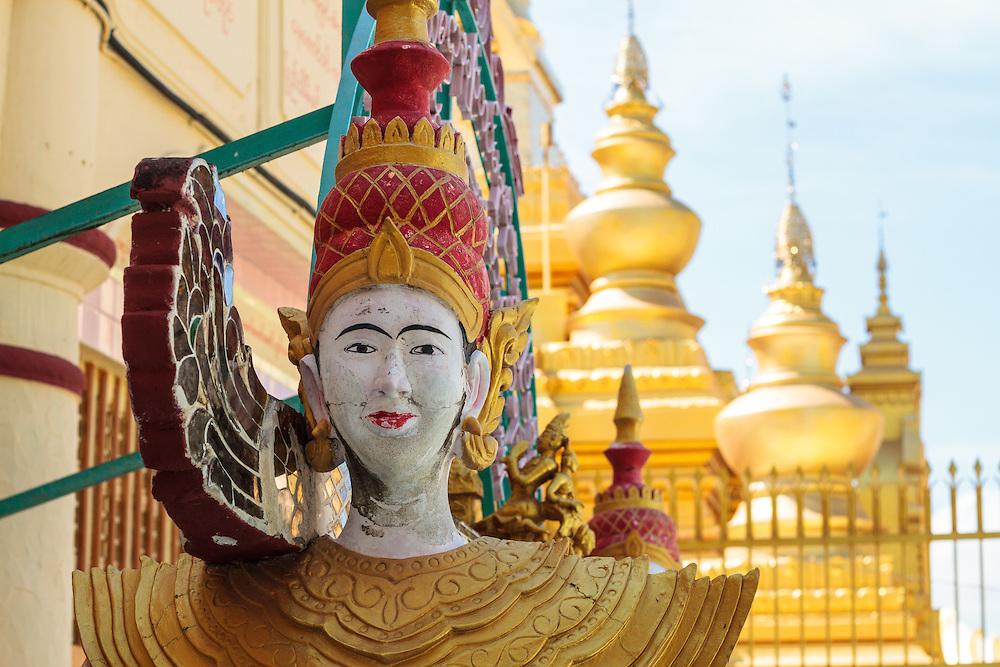 Figurine guards temple in Mandalay.