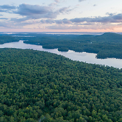 An aerial view of Crescent Lake and the Raymond Community Forest in Raymond, Maine.