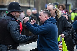 London, UK. 21st January, 2019. Supporters of Yellow Vests UK confront a Remainer (out of picture) outside the Houses of Parliament,