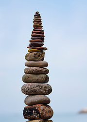 Stack of stones supported on rock