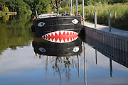 Boat on River Avon at Fladbury with a face painted on its bow, Worcestershire, England