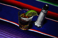A shot of tequila with salt and lime.