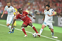 KIEV, UKRAINE - MAY 26: Sadio Mane of Liverpool competes with Isco of Real Madrid during the UEFA Champions League final between Real Madrid and Liverpool at NSC Olimpiyskiy Stadium on May 26, 2018 in Kiev, Ukraine. (MB Media)