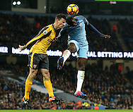Laurent Koscielny of Arsenal challenges Yaya Toure of Manchester City during the English Premier League match at the Etihad Stadium, Manchester. Picture date: December 18th, 2016. Picture credit should read: Simon Bellis/Sportimage