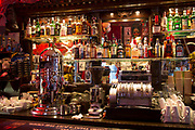Scene inside the elaborately decorated Bridge Cafe in Shoreditch, London, UK. The interior of this bar is a treasure trove of nik naks and objects and gives the impression of a New York bar.