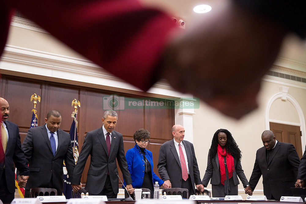 President Barack Obama joins hands with Transportation Secretary Anthony Foxx and Senior Advisor Valerie Jarrett during a prayer with African American faith and civil rights leaders prior to a meeting in the Eisenhower Executive Office Building of the White House, Feb. 26, 2015. (Official White House Photo by Pete Souza)<br /> <br /> This official White House photograph is being made available only for publication by news organizations and/or for personal use printing by the subject(s) of the photograph. The photograph may not be manipulated in any way and may not be used in commercial or political materials, advertisements, emails, products, promotions that in any way suggests approval or endorsement of the President, the First Family, or the White House.