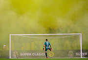 Chivas de Guadalajara's Raul Gudino kicks a smoke grenade thrown on the field during the second half of the Super Clasico soccer match against Club America Sunday, Sept. 8, 2019, in Chicago.   (AP Photo/Jim Young)
