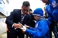 Eduardo Vargas of Queens Park Rangers signing autographs to a fan outside Loftus Road stadium before k/o. Barclays Premier league match, Queens Park Rangers v Leicester city at Loftus Road in London on Saturday 29th November 2014.<br /> pic by John Patrick Fletcher, Andrew Orchard sports photography.