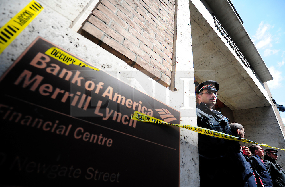 © Licensed to London News Pictures. 15/05/2012. London,Britain.Occupy London members protest against against the finance industry in fron of the Bank of America .  Photo credit : Thomas Campean/LNP