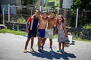 Children posing for a picture at the main road in the village of Rankovce. Rankovce is located about 30 km from Kosice and has all together 788 inhabitants. About 80% of them are of Roma ethnicity (629). The overall unemployment rate is about 75%, and estimated about 99% in between the Roma community. The foundation ETP Slovakia has a project in Rankovce setting up micro-loan funds for the local Roma community.
