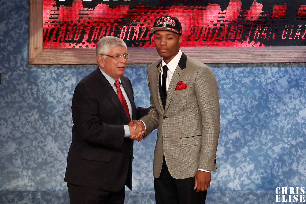 28 June 2012: Damian Lillard, picked up by the Portland Trailblazers, poses with David Stern during the 2012 NBA Draft, at the Prudential Center, Newark, New Jersey.