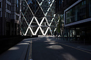 Architectural reflections of light near The Gherkin in the City of London, England, United Kingdom.