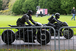 © Licensed to London News Pictures. 13/10/2020. Liverpool, UK. Batman and Catwoman stunt doubles film a scene at Anfield Cemetery, Liverpool for The Batman movie. Photo credit: Kerry Elsworth/LNP