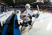 KELOWNA, CANADA - JANUARY 26:  Roman Basran #30 of the Kelowna Rockets throws pucks to the ice at the start of warm up against the Vancouver Giants on January 26, 2019 at Prospera Place in Kelowna, British Columbia, Canada.  (Photo by Marissa Baecker/Shoot the Breeze)