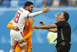 (l-r) Alireza Jahanbakhsh of IR Iran, goalkeeper Amir Abedzadeh of IR Iran