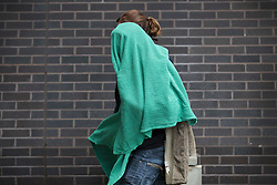 Licensed to London News Pictures. 20/10/2016. Croydon, UK. A migrant from the Calais jungle camp covers their face as they arrive at the Home Office immigration centre in Croydon. British authorities are bringing over about 100 children this week to be reunited with their relatives. French authorities are expected to start dismantling the camp this week. Photo credit: Peter Macdiarmid/LNP