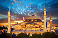 The exterior of the 6th century Byzantine (Eastern Roman) Hagia Sophia ( Ayasofya ) at sunset, built by Emperor Justinian. The size of the dome was un-surpassed until the 16th century, Istanbul, Turkey .<br /> <br /> If you prefer to buy from our ALAMY PHOTO LIBRARY  Collection visit : https://www.alamy.com/portfolio/paul-williams-funkystock/hagia-sophia-istanbul.html<br /> <br /> Visit our TURKEY PHOTO COLLECTIONS for more photos to download or buy as wall art prints https://funkystock.photoshelter.com/gallery-collection/3f-Pictures-of-Turkey-Turkey-Photos-Images-Fotos/C0000U.hJWkZxAbg
