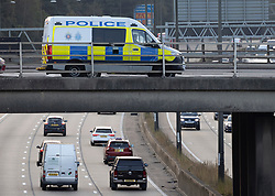 © Licensed to London News Pictures. 20/09/2021. Leatherhead, UK. Police watch a junction on the M25 motorway near Cobham, Surrey - as Insulate Britain climate activists are expected to continue their campaign today. Climate activists have stated that they will continue their campaign of disruption ahead of the 26th UN Climate Change Conference of the Parties (COP26) being hosted in Glasgow, Scotland on 31 October. Photo credit: Peter Macdiarmid/LNP