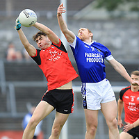 Clondegad's Morgan Garry and Cratloe's Conor Cooney jump to catch the ball