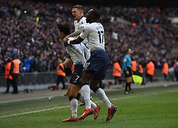 Tottenham Hotspur's Son Heung-min celebrates scoring their first goal with team mates