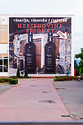 Advertising poster billboard on the outside of the winery. Hercegovina Produkt winery, Citluk, near Mostar. Federation Bosne i Hercegovine. Bosnia Herzegovina, Europe.
