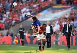 Chelsea's Marcos Alonso (left) and Manchester United's Antonio Valencia battle for the ball