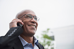 African businessman using mobile phone reliable