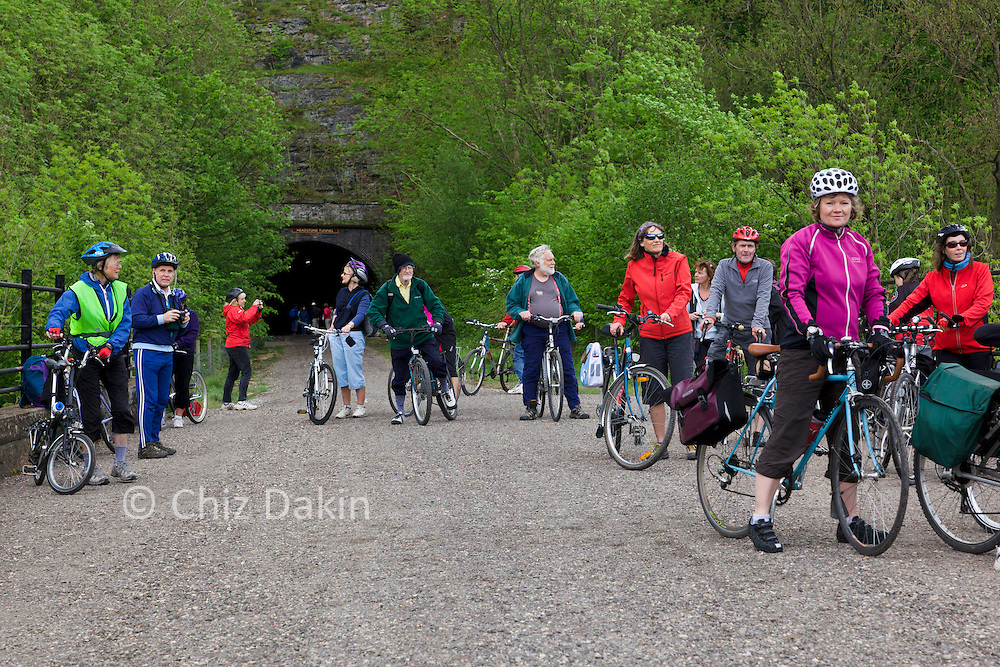 Cyclists stopping to admire the view and regroup after cycling through the newly re-opened Headstone tunnel, the longest tunnel in the newly reopened Monsal Tunnels section of the Monsal Trail, in Derbyshire