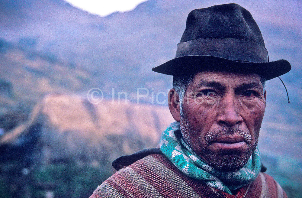 "A native "" Pansaleo"" man high up in the Andes mountain range in his small farming community, near Simiatug, Ecuador"