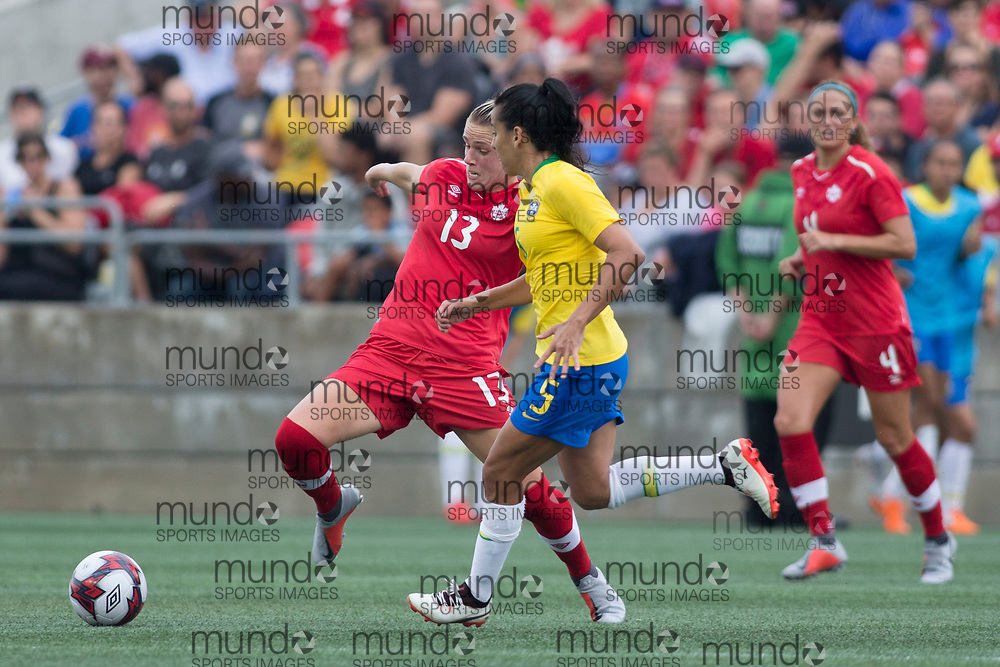 OTTAWA, ON - September 2: Sophie Schmidt (13 -- M) of Canada pushes the ball past Thaisa (5 -- M) of Brazil in an international FIFA women's friendly soccer match between Canada and Brazil at TD Place Stadium in Ottawa, Canada, September 2, 2018. Canada defeated Brazil 1-0. (Photo by Sean Burges/Mundo Sport Images)