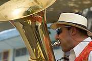 A man playing the tuba