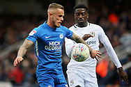 Coventry City forward Jordy Hiwula (11) and Peterborough Utd midfielder Joe Ward (15) during the EFL Sky Bet League 1 match between Peterborough United and Coventry City at London Road, Peterborough, England on 16 March 2019.