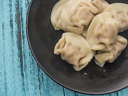 July 19, 2017 - Hangzh, Hangzh, China - Dumpling is a kind of traditional Chinese food often wrapped around a filling (as in ravioli or wontons). The dough can be based on bread, flour, or potatoes, and may be filled with fish, meat, sweets, or vegetables. They may be prepared using a variety of methods, including, but not limited to, baking, boiling, frying, simmering, or steaming. (Credit Image: © SIPA Asia via ZUMA Wire)