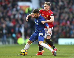 Chelsea's Olivier Giroud (left) and Manchester United's Scott McTominay battle for the ball