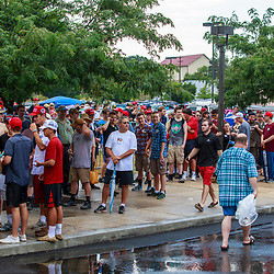 Mechanicsburg, PA – August 1, 2016: Despite rain showers, supporters stand in line waiting to enter a school building to see Republican presidential candidate Donald J Trump.