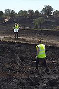 Dorset Wildlife Trust volunteers rescuing reptiles from the heath fire. Upton Heath, Dorset, UK.