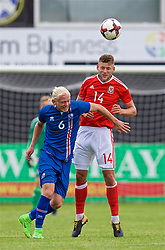 RHYL, WALES - Monday, September 4, 2017: Wales' Brandon Cooper and Iceland's Kolbeinn Birgir Finnsson during an Under-19 international friendly match between Wales and Iceland at Belle Vue. (Pic by Paul Greenwood/Propaganda)