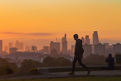 Primrose Hill, London, October 4th 2016. Dawn breaks across London, throwing the city's skyline, seen from Primrose Hill, into silhouette.
