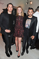 Left to right, TOMAS AUKSAS, AMBER ATHERTON and PABLO GANGULI at a party hosted by Ines de la Frassange and Bruno Frisoni for Roger Vivier to launch the Roger Vivier book held at The Saatchi Gallery, London on 24th April 2013.