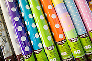 Rolls of wrapping paper are on display at Party Fever, a new party super-store located near Dempsey Road in Milpitas, California, on July 31, 2014. (Stan Olszewski/SOSKIphoto)