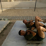 US Marines from the 24th Marine Expeditionary Unit (MEU) Battle Landing Team (BLT) 1/6 Alpha Company work out in an open air gym at Forward Operating Base Apache North in Garmsir District, Helmand Province, Afghanistan. Garmsir has been a haven for insurgents for the last several years. Earlier this year the Marines cleared the area after a period of heavy fighting and recently handed over control to British Forces.