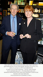 MAJ.GEN.KEN PERKINS and his wife writer CELIA SANDYS granddaughter of war time leader Winston Churchill, at a party in London on 8th April 2003.	PIS 30
